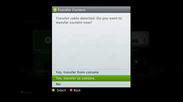 A screen prompts the user with the message, 'Transfer cable detected. Do you want to transfer content now?', along with clickable Yes and No options.