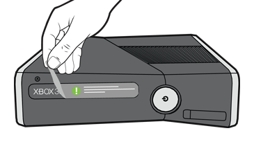 An illustration shows a hand pulling protective tape off the front of the Xbox 360 console.