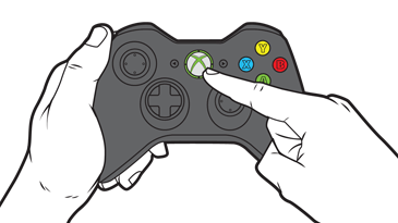 A finger reaches to press the large Guide button near the center of an Xbox 360 controller.