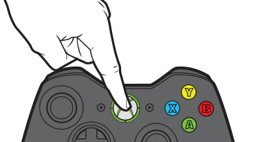 A finger presses the Guide button on an Xbox 360 wireless controller.